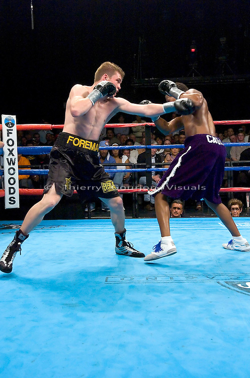 Yuri Foreman (black and gold) on the attack against Kevin Cagle during their Junior Middleweight Fight at the Foxwoods Resort Casino in Mashantucket, CT, on 05.06.2005..Foreman won by unanimous decision.