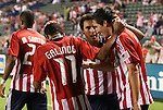 22 August 2009: Chivas USA's Sacha Kljestan (right) celebrates his first goal with Jonathan Bornstein, Maykel Galindo (11), and Maicon Santos (29). CD Chivas USA played Toronto FC at the Home Depot Center in Carson, California in a regular season Major League Soccer game.