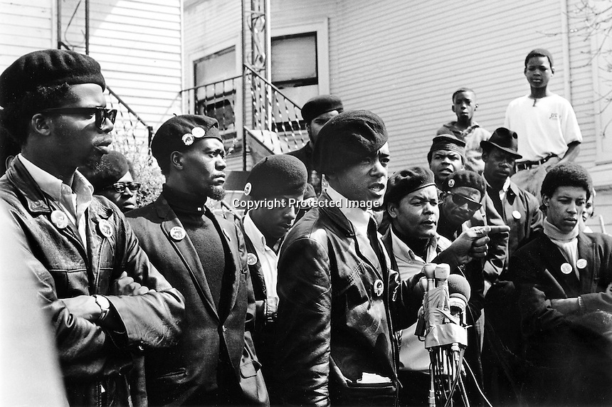 Black Panther press conference in Oakland, Ca  after the shooting of one of their members 17-year old Bobby Hutton. Hutton was shot by Oakland Police when he and Panther Elridge Cleaver were envolved in a shootout with police. (center)at microphones is  Bobby Seale, and to his left is William Lee Brent. (1968 photo by Ron Riesterer)