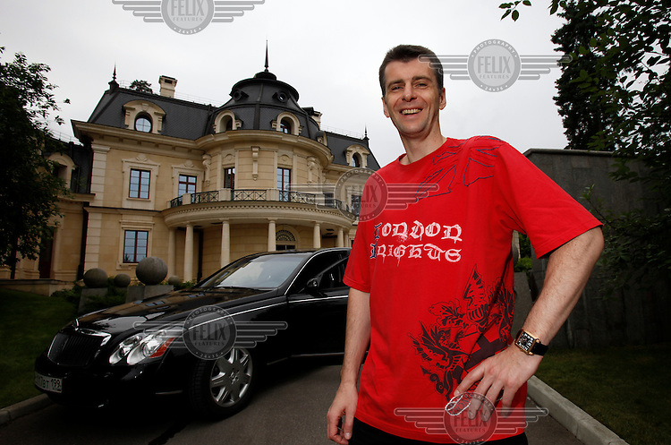 Mikhail Prokhorov, Russia's richest man in 2009, poses in front of his Maybach car at his country residence outside Moscow. Prokorov made his fortune in investments. In 2009 his estimated net worth was $9.5 billion, making him the world's 40th richest person. He is the former chairman of Norilsk Nickel and current chairman of Polyus Gold.
