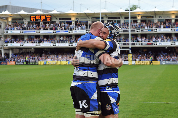 Matt Garvey and Leroy Houston of Bath Rugby celebrate after the match. Aviva Premiership semi-final, between Bath Rugby and Leicester Tigers on May 23, 2015 at the Recreation Ground in Bath, England. Photo by: Patrick Khachfe / Onside Images