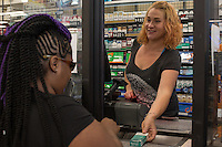 Cashier Lindsay Abdullah (CQ) sells Newport Cigarettes to a customer at Penny Saver Food and Gas, 2715 S Elm-Eugen Street, Greensboro, NC on Monday, July 11, 2016. (Justin Cook for The Wall Street Journal)<br /> <br /> TOBACCO<br /> <br /> Story Summary: Japan Tobacco Inc. is quietly invading U.S. tobacco country with a new discount cigarette brand. At Penny Saver Food and Gas near downtown Greensboro, N.C., the company&rsquo;s LD cigarettes have prime placement, around eye level in the middle of the section, allowing them to stand out alongside established brands like Marlboro, Newport and Camel. Its $2.81 price tag compares favorably with Marlboro at $5.25 and puts it in position to challenge discount brands L&amp;M at $3.69 and Pall Mall at $3.73. The red, blue, green and silver packs of cigarettes with the LD logo stamped on the right corner are part of a plan to give the world&rsquo;s second-largest tobacco company a toehold in the lucrative U.S. market. Almost all of Japan Tobacco&rsquo;s roughly $21 billion in sales comes from outside the U.S. LD is the first global brand the company introduced in the U.S. in March. The company said it is testing the discount cigarette&rsquo;s appeal in North Carolina and South Carolina and will launch the brand nationwide depending on its performance as early as next year with 10 style variations. Japan Tobacco&rsquo;s investment in LD is part of an about face for Big Tobacco. After years of spurning the U.S. because of mounting civil suits, international tobacco companies are returning as the country becomes more attractive than international markets. Legal risks here are fading and prices are rising. Plus, thanks to the First Amendment, companies here are protected from having to use plain packaging or apply graphic warning labels that show images of gangrene feet, rules currently gaining momentum worldwide. The Tokyo-based company has increased its staff in the U.S. by 20% over the past five years to 147 employees and invested heavily in the U.S. e-cigarette company Lo