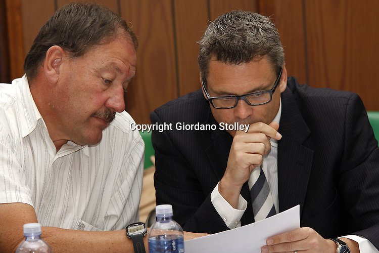 DURBAN - 12 February 2014 - Structural engineer Andre Ballack speaks to his lawyer Richard Hoal at a commission of inquiry held by the Department of Labour into the events that led to a Tongaat Mall collapsing, killing two people and injuring 29 on November 19, 2013. Ballack was the structural ingineer for the project. Picture: Allied Picture Press/APP