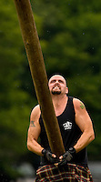 A competitor prepares to throw the caber in the heavy Scottish Athletic Events during the 52nd Annual Grandfather Mountain Highland Games in Linville, NC.