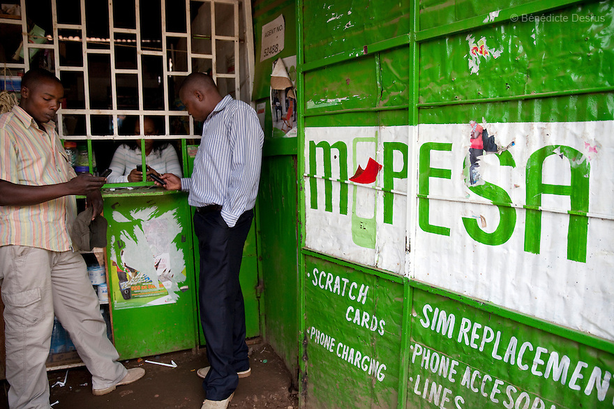 Kenyan customers at an M-Pesa service outlet in Nairobi, Kenya on April 3, 2013. M-Pesa is a mobile-phone based money transfer and microfinancing service for Safaricom and vodacom, the largest mobile network operator in Kenya and Tanzania. Currently the most developed mobile payment system in the developing world, M-Pesa allows users with a national ID card or passport to deposit, withdraw, and transfer money easily with a mobile device. (Photo by Benedicte Desrus)