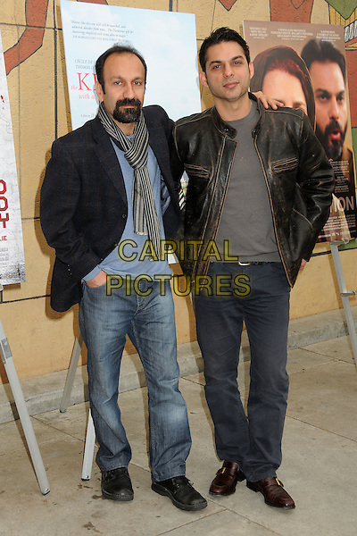 Asghar Farhadi and Peyman Moaadi.American Cinematheque 69th Annual Golden Globe Awards Foreign-Language Nominee Directors Panel held at the Egyptian Theatre, Hollywood, California , USA..January 14th, 2012.full length blue top jeans denim hands in pockets black goatee facial hair striped stripes scarf leather jacket brown .CAP/ADM/BP.©Byron Purvis/AdMedia/Capital Pictures.