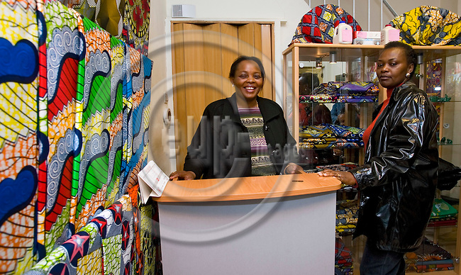 BRUSSELS - BELGIUM - 30 MARCH 2007 -- Matonge the African quarter of Brussels in Ixelles. -- The owner of the cloth shop Gosen Aditex behind the counter with a client. -- PHOTO: JUHA ROININEN / EUP-IMAGES