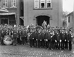 Monitor Hose Co. posed in front of the firehouse with members of the Wheeler and Wilson Band, of Bridgeport, 1893.