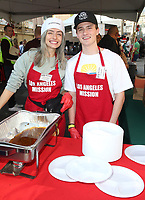 21 December 2018 - Los Angeles, California - Kirsten Collins, Crawford Collins. Los Angeles Mission Christmas Meal for the Homeless held at Los Angeles Mission. Photo Credit: F. Sadou/AdMedia