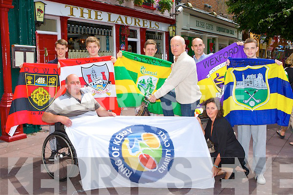 Busy volunteers who are preparing the flags of Ireland to be hung up in Killarney town to welcome all the Ring of Kerry Cyclists front l-r: Tim O'Connor and Kate O'Leary. Back row: David Wallace, David Leen, Robert Leen, Johnny McGuire, Darragh O'Brien and Robert Lee