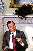 United States President George H.W. Bush speaks to the press pool in the Oval Office of the White House in Washington, D.C. during his first full day as President on January 21, 1989. <br /> Credit: Dennis Brack / Pool via CNP