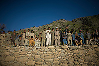 Children wait while elders handout humanitarian aid donated from Delta-4, 1-26 Infantry via the Afghan National Army in Shilam in the Pesh Valley. Delta-4, 1-26 Infantry visited elders in the village to hand out humanitarian aid via the Afghan National Army and maintain support in this pro-coalition village in a pro-Taliban area.