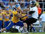BROOKINGS, SD - SEPTEMBER 20:  Dallas Brown #15 from South Dakota State pulls down Manfred Johnson #2 from Wisconsin-Oshkosh in the first half of their game Saturday at Coughlin Alumni Stadium in Brookings. (Photo/Dave Eggen/Inertia)