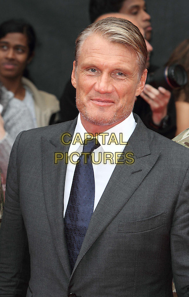 Dolph Lundgren.'The Expendables 2' UK film premiere held at the Empire Leicester Square,.London, England..13th August 2012.half length grey gray suit white shirt blue tie  stubble facial hair .CAP/ROS.©Steve Ross/Capital Pictures.
