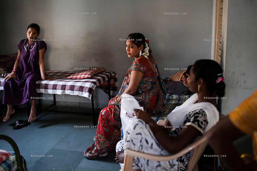 Bharti Utrekar (center), a surrogate, waits to go back to the Akanksha Infertility Center surrogate hostel after her joint baby shower, organised on the 7th month of pregnancy, in the surrogate's house in Anand, Gujarat, India on 11th December 2012. Photo by Suzanne Lee / Marie-Claire France
