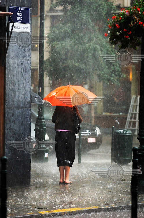 Woman in pouring rain.