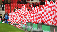 Mascots wave flags prior to kick off of the Premier League match between Stoke City and Swansea City at the bet365 Stadium, Stoke on Trent, England, UK. Saturday 02 December 2017