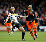Ben Purkiss of Port Vale in action with Leon Clarke of Sheffield Utd during the English League One match at Vale Park Stadium, Port Vale. Picture date: April 14th 2017. Pic credit should read: Simon Bellis/Sportimage