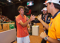 13-sept.-2013,Netherlands, Groningen,  Martini Plaza, Tennis, DavisCup Netherlands-Austria, First Rubber,  Robin Haase (NED) is congratulated by team member Jesse Huta Galung<br /> Photo: Henk Koster