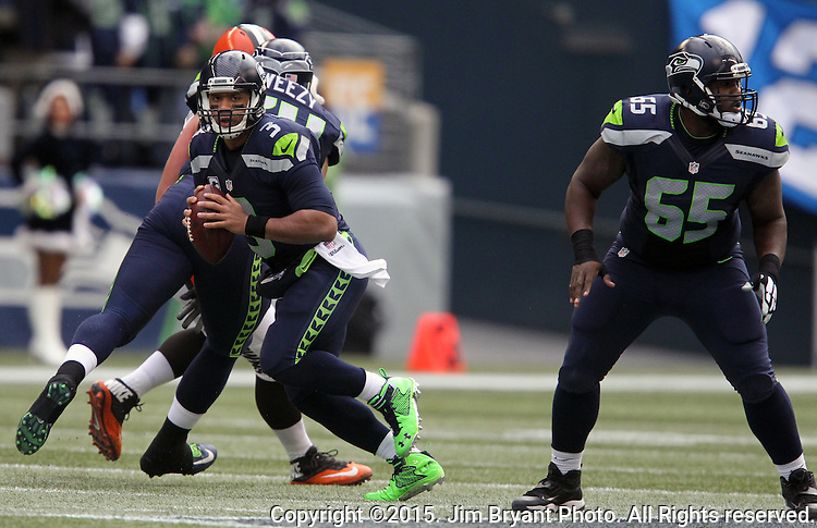 Seattle Seahawks quarterback Russell Wilson (3) scrambles against the Cleveland Browns at CenturyLink Field in Seattle, Washington on December 20, 2015. The Seahawks clinched their fourth straight playoff berth in four seasons by beating the Browns 30-13.  ©2015. Jim Bryant Photo. All Rights Reserved.