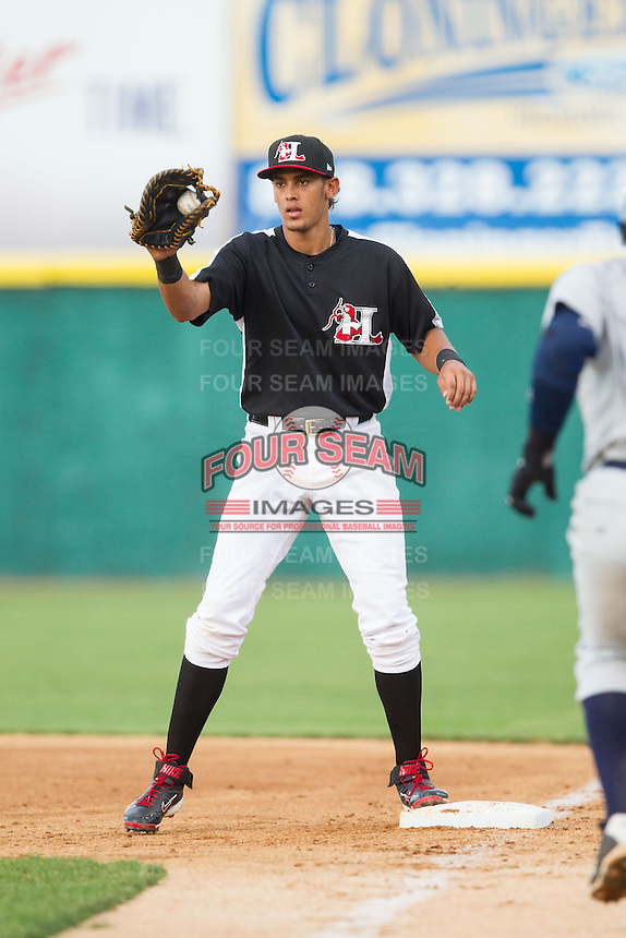 Ronald Guzman (22) of the Hickory Crawdads fields a throw at first base during the game against the Charleston RiverDogs at L.P. Frans Stadium on June 2, 2014 in Hickory, North Carolina.  The Crawdads defeated the RiverDogs 9-6.  (Brian Westerholt/Four Seam Images)