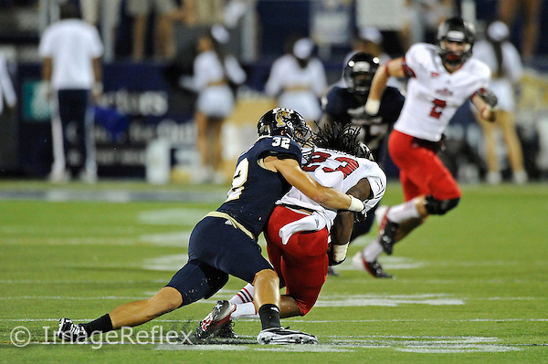 4 October 2012:  FIU safety Justin Halley (32) tackles Arkansas State wide receiver J.D. McKissic (23) in the fourth quarter as the Arkansas State University Red Wolves defeated the FIU Golden Panthers, 34-20, at FIU Stadium in Miami, Florida.