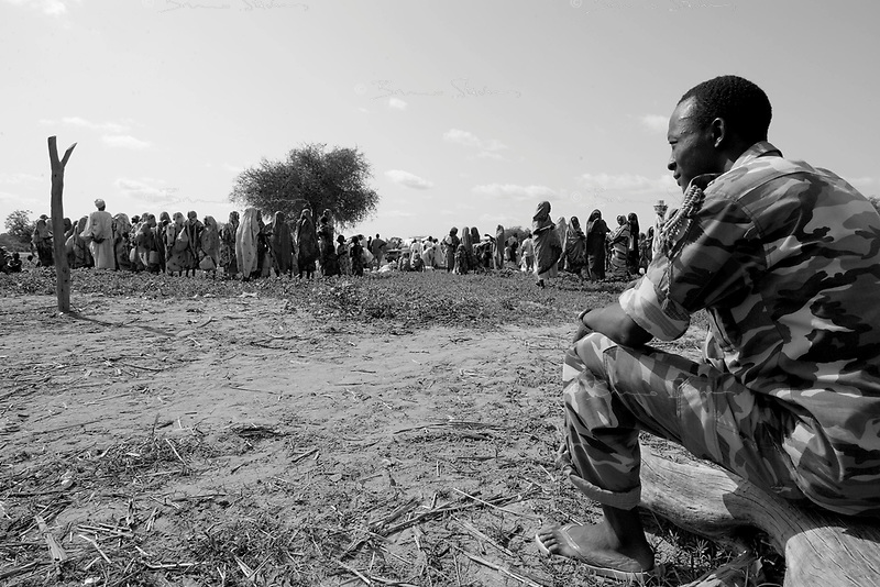 Goker, West Darfur, August 10, 2004.Sudanese policeman on duty during a WFP food distribution operation.