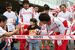 September 30, 2017, Tokyo, Japan - The last runnercrosses the finish line of a family run at a charity run for the Special Olympics at Toyota's showroom Mega Web in Tokyo on Saturday, September 30, 2017. Some 1,800 people participated the charity event as Japan's Special Olympic Games will be held in Aichi in 2018.   (Photo by Yoshio Tsunoda/AFLO) LWX -ytd-