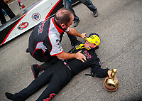 Aug 19, 2018; Brainerd, MN, USA; NHRA top fuel driver Billy Torrence (right) celebrates with crew member Bobby Lagana after winning the Lucas Oil Nationals at Brainerd International Raceway. Mandatory Credit: Mark J. Rebilas-USA TODAY Sports