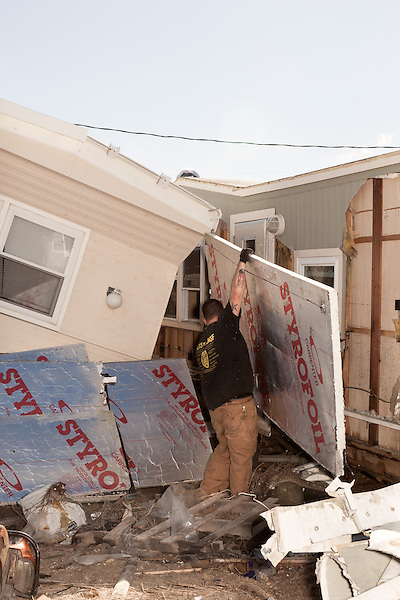 February 27, 2013. Holgate, New Jersey. A demolition crew dismantles a wrecked home in a trailer park that has no livable residences after Hurricane Sandy hit the area.. Tracing the path of Hurricane Sandy, which wrecked havoc on the northeastern seaboard from October 25-31, 2012. The storm caused flooding and caused an estimated 60 billion dollars worth of damage to affected areas.