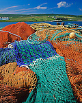 County Kerry, Ireland<br /> Fishing nets on the Portmagee Wharf with Valencia Island across the Portmagee Channel