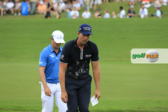 Henrik Stenson (SWE) drained with the searing heat as he finishes on the 18th green during Saturday's Round 3 of the 2017 PGA Championship held at Quail Hollow Golf Club, Charlotte, North Carolina, USA. 12th August 2017.<br /> Picture: Eoin Clarke | Golffile<br /> <br /> <br /> All photos usage must carry mandatory copyright credit (&copy; Golffile | Eoin Clarke)