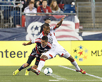New England Revolution midfielder Diego Fagundez (14) attempts to control the ball under strong pressure from D.C. United defender Ethan White (15). In a Major League Soccer (MLS) match, the New England Revolution (blue) defeated D.C. United (white), 2-1, at Gillette Stadium on September 21, 2013.