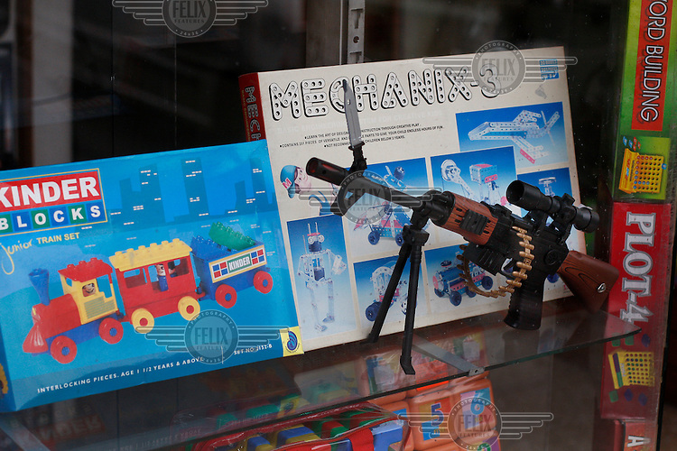 Toys, including a gun, in shop window. Srinagar, Kashmir,India. © Fredrik Naumann/Felix Features