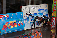Toys, including a gun, in shop window. Srinagar, Kashmir,India. © Fredrik Naumann/Felix Features