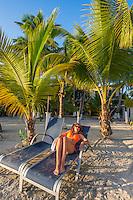 Honduras, Roatan Island, Fantasy Island Resort, Caribbean. Woman relaxing at the beach (Sam).