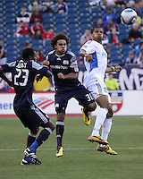 New England Revolution defender Kevin Alston (30) and San Jose Earthquakes forward Ryan Johnson (19) compete for a high ball.  The New England Revolution and San Jose Earthquakes play to a scoreless draw at Gillette Stadium on May 15, 2010