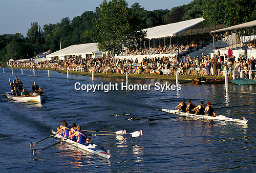'HENLEY ROYAL REGATTA', FOLLOWED BY THE JUDGES' LAUNCH 2 CREWS BATTLE IT OUT IN FRONT OF THE MEMBERS' ENCLOSURE