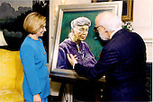 Washington, D.C. - May 26, 1994 -- First lady Hillary Rodham Clinton accepts a Daniel Greene portrait of Eleanor Roosevelt..The portrait is the third of a series painted by Mr. Greene in the late 1950's.  Mr. Greene is a resident of Studio Hill Farm, North Salem, New York..Credit: The White House via CNP
