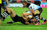 New Zealand's Simon Mannering is tackled during the 2017 Rugby League World Cup quarterfinal match between New Zealand Kiwis and Fiji at Westpac Stadium in Wellington, New Zealand on Saturday, 18 November 2017. Photo: Mike Moran / lintottphoto.co.nz
