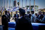 Israeli Prime Minister Benjamin Netanyahu, left, and Israeli President Reoven Rivlin pay their respect to Former president Shimon Peres's casket placed outside the Knesset Israelis parliament in Jerusalem so that the public may pay its last respects on Thursday Sept 29 2016. Peres 93 passed away Tuesday, he was the last member of Israel's founding generation, and was feted internationally as a visionary man of peace. Photo by Eyal Warshavsky