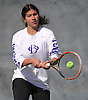 Celeste Matute of of Oyster Bay returns a volley during the Nassau County varsity girls' tennis doubles final at Eisenhower Park on Sunday, October 18, 2015. She and teammate Courtney Kowalsky won the match to claim the doubles county championship.<br /> <br /> James Escher
