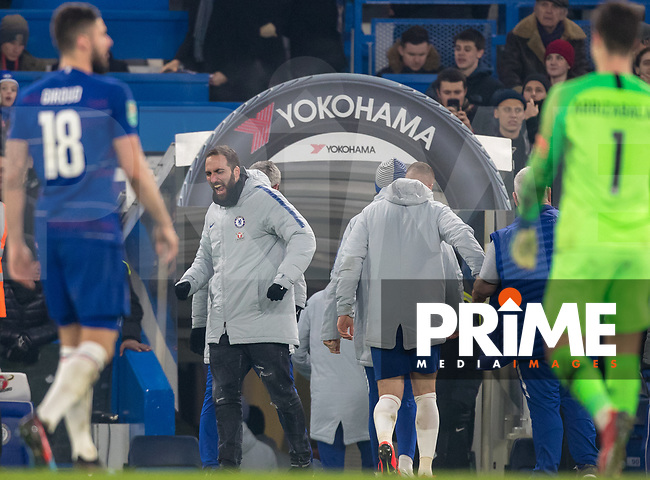 Gonzalo HIGUAIN of Chelsea celebrates his teams win after a penalty shootout during the Carabao Cup Semi-Final 2nd leg match between Chelsea and Tottenham Hotspur at Stamford Bridge, London, England on 24 January 2019. Photo by Andy Rowland.