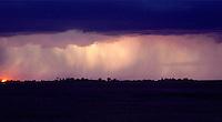 Storm clouds and rain at dusk indicating a pending storm. Aberdeen South Dakota.