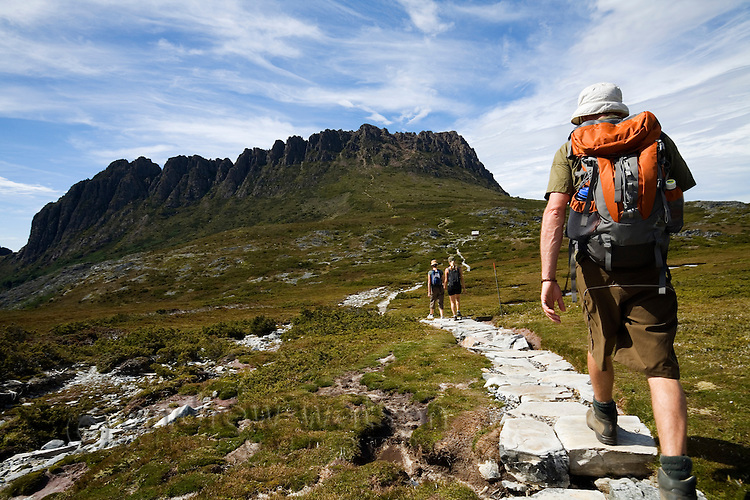 A man hikes the Overland Track at Cradle Mountain.  Cradle Mountain-Lake St Clair National Park, Tasmania, AUSTRALIA