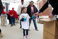 A young Springfield Cardinals fan is handed a box with a 2012 Texas League Championship replica ring prior to a game against the Tulsa Drillers at Hammons Field on May 4, 2013 in Springfield, Missouri. (David Welker/Four Seam Images)