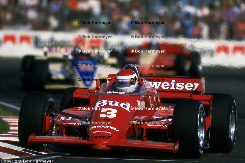 MIAMI, FL - NOVEMBER 9: Bobby Rahal leads a group of cars in his March 85C/Cosworth during the Miami Indy Challenge IndyCar race on November 9, 1985, at Tamiami Park in Miami, Florida.