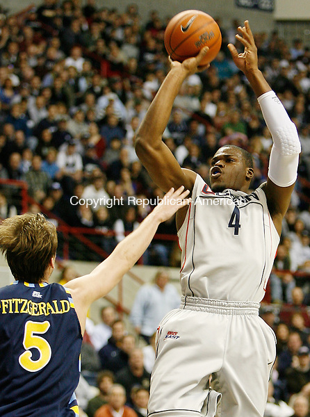 Storrs, CT-20 January 2008-012001MK05 UConn's  #4 Jeff Adrien puts up a jumpshot against Marquette's  #5 Dan Fitzgerald  Sunday's game at Gampel Pavilion.  Connecticut won the contest 89 - 73 over the Golden Eagles. Michael Kabelka / Republican-American (#4 Jeff Adrien puts up a jumpshot against Marquette's  #5 Dan Fitzgerald)CQ