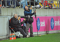 Photographers Ross Setford (SNPA, left) and Ross Giblin (Dominion Post) during the ANZAC Day AFL match between St Kilda Saints and Brisbane Lions at Westpac Stadium, Wellington, New Zealand on Friday, 25 April 2014. Photo: Dave Lintott / lintottphoto.co.nz
