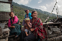 Nima with her son and neighbors in Briddhim. Tamang Heritage Trail, Nepal, 07 May 2013.